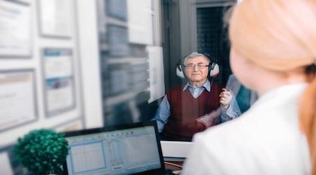 man during hearing test